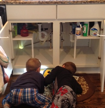 Boys helping with plumbing